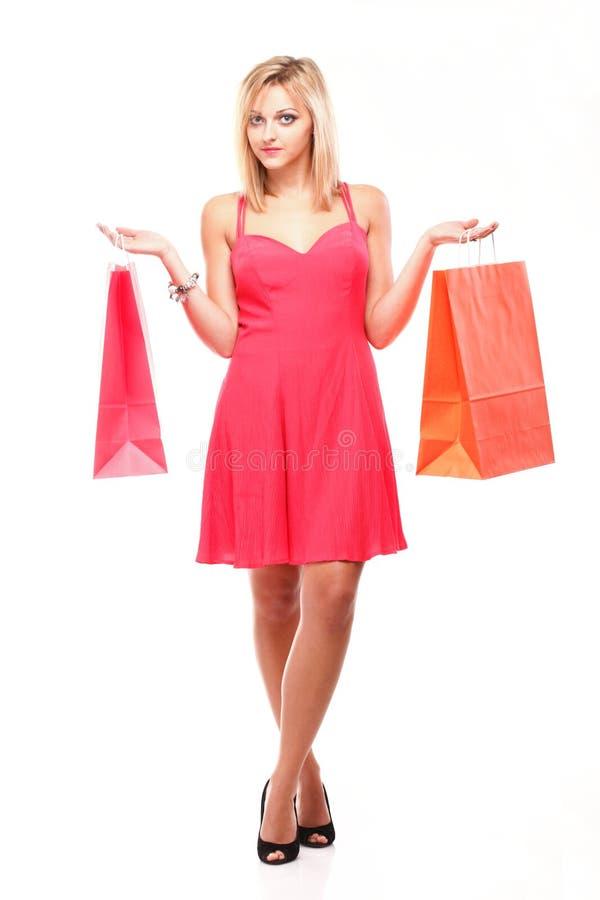 Mooie vrouw met het winkelen zakken stock afbeelding