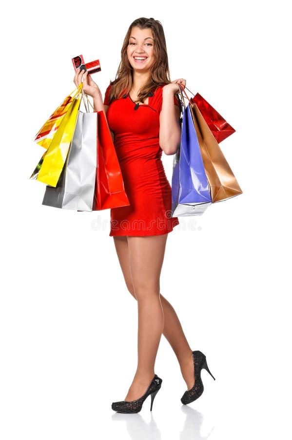 Mooie vrouw met het winkelen zakken en kortingskaarten stock fotografie
