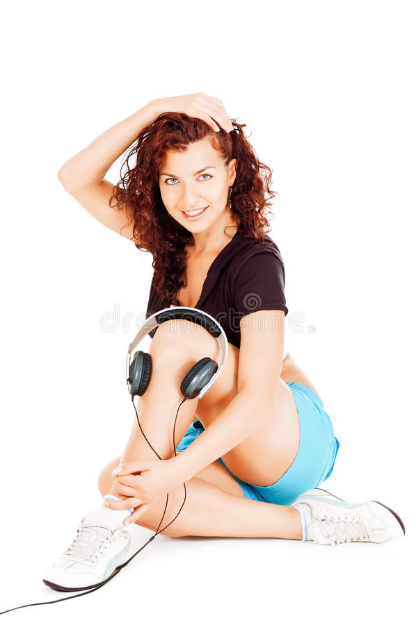 Mooie vrouw met hoofdtelefoons royalty-vrije stock foto