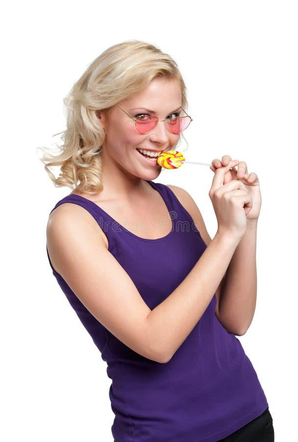 Mooie vrouw met lollypop royalty-vrije stock afbeeldingen