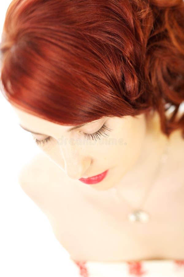 Mooie vrouw met rood haar royalty-vrije stock afbeelding