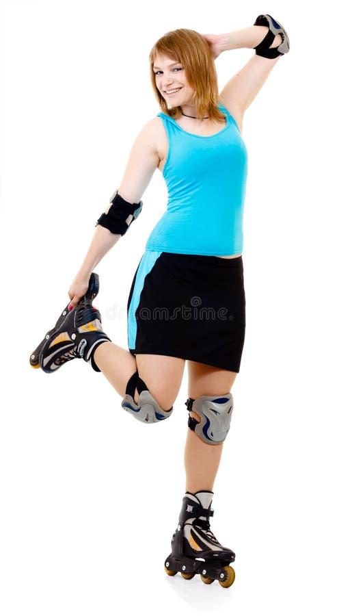 Mooie vrouw op rolschaatsen stock fotografie