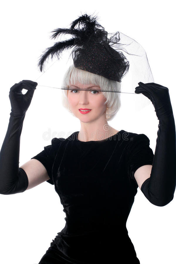 Mooie vrouw in retro stijl in hoed stock afbeelding