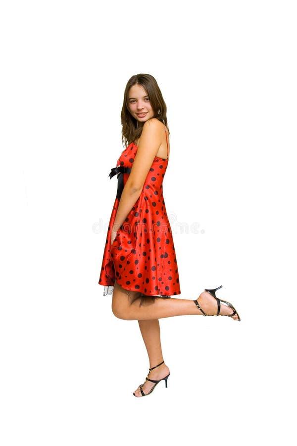 Mooie vrouw in rode kleding die op wit wordt geïsoleerd royalty-vrije stock fotografie