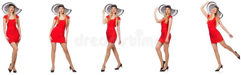 Mooie vrouw in rode kleding die op wit wordt ge?soleerd stock foto