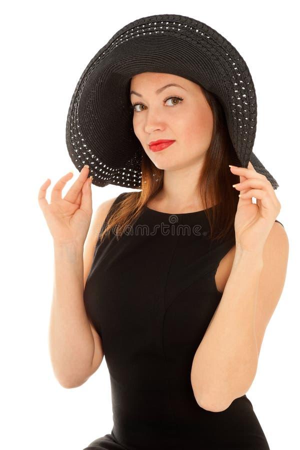Mooie vrouw in weinig zwarte die kleding op wit wordt geïsoleerd royalty-vrije stock afbeelding