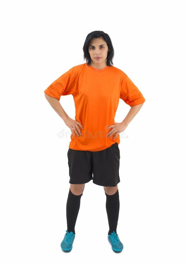 Mooie vrouwelijke geïsoleerde voetballer stock foto