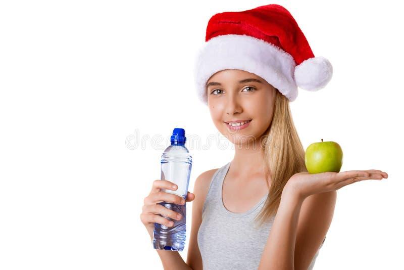 Mooie vrouwelijke model geïsoleerde holdingsappel en fles water, stock foto