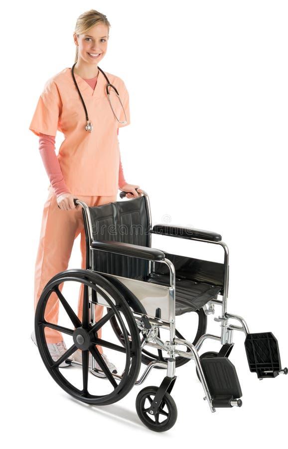 Mooie Vrouwelijke Verpleegster With Wheelchair royalty-vrije stock afbeeldingen