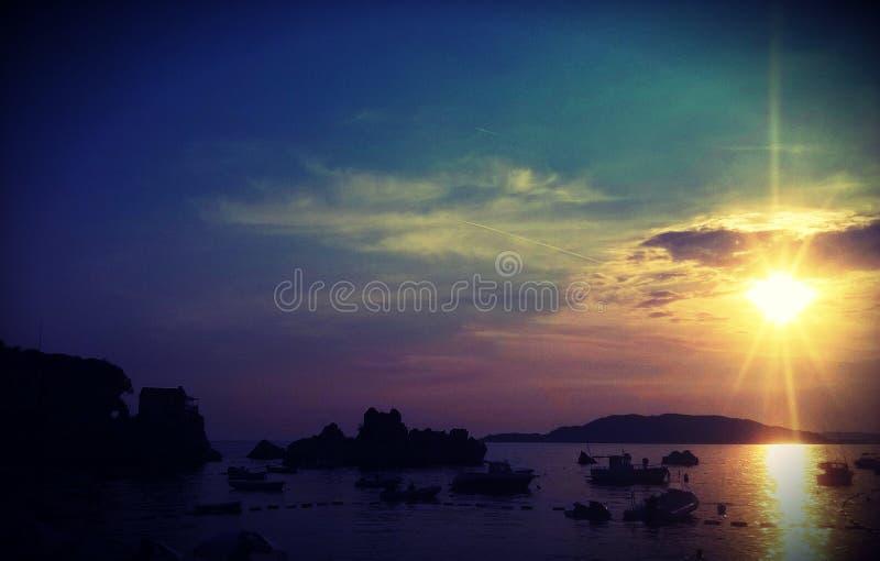 Mooie zonsondergang en overzees, Budva, Montenegro, Europa royalty-vrije stock afbeelding