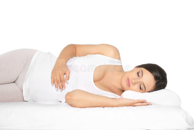 Mooie zwangere vrouwenslaap met orthopedisch hoofdkussen op bed royalty-vrije stock afbeeldingen