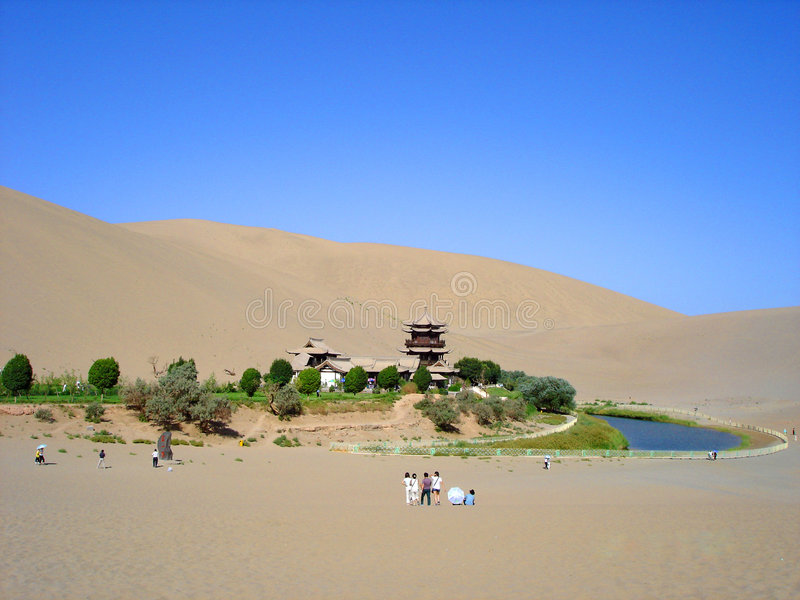 The Moom lake in the desert. The blue Moom lake in the desert, Dun Huang, Gansu China,China. The lake is surrounded by sands and desert stock photo