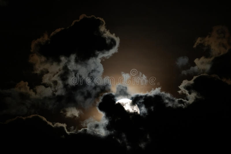 The moon. Full moon and clouds on night sky royalty free stock photos