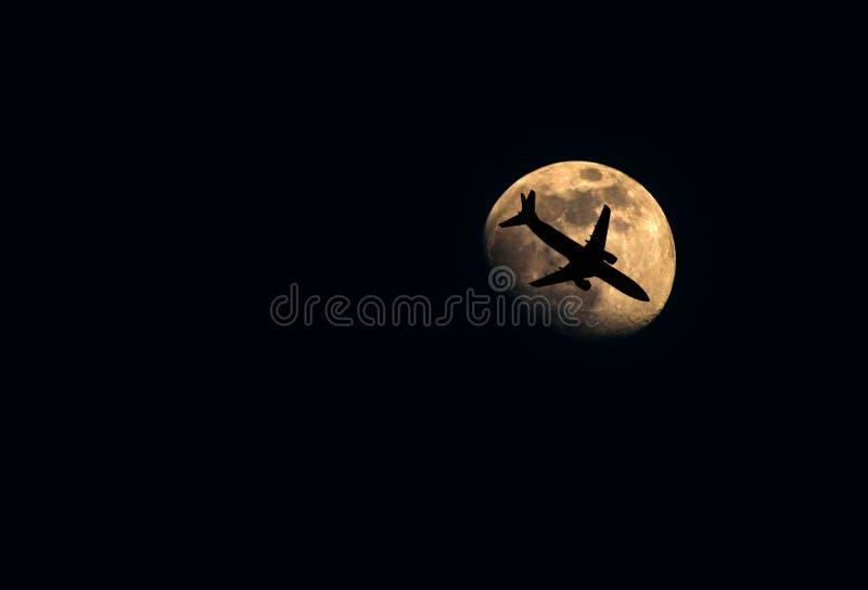 Moon with aeroplane stock image