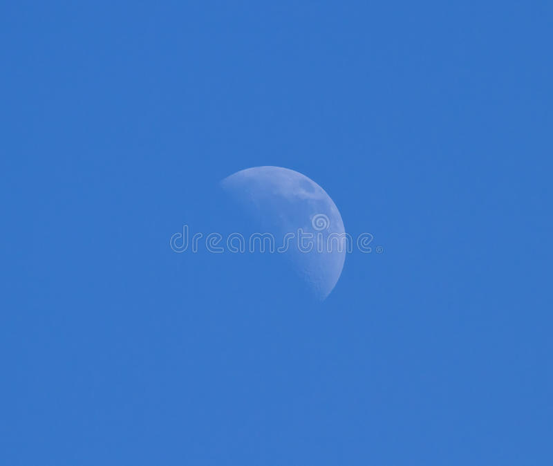 Moon Against Blue Sky stock images