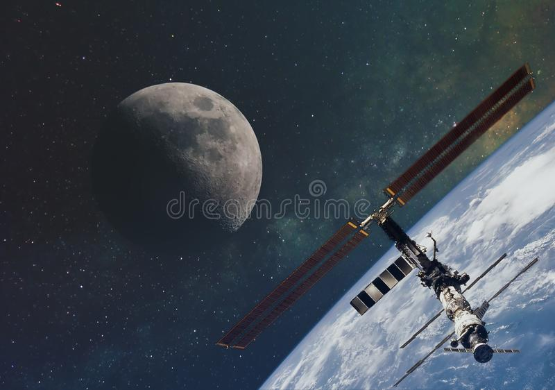 The moon against the milky way and the international space station in the infinite space of the universe in orbit of the earth. El. Ements of this image stock image
