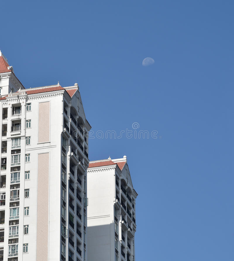 Moon and apartments stock photos
