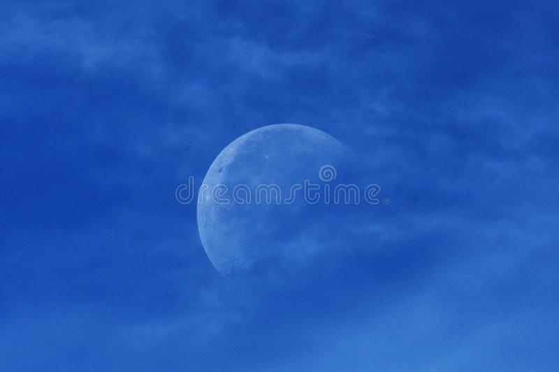 Moon and blue clouds after sunset. Moon and blue clouds, after sunset. over Baltic sea in Latvia royalty free stock photo