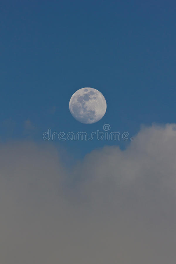 Moon at blue sky stock photography