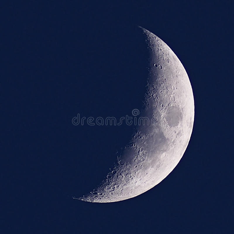 Half Moon in night blue sky stock photo