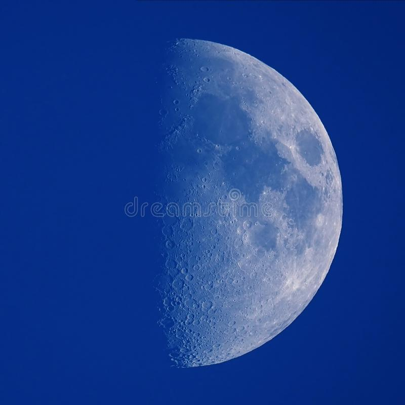 Half Moon details in blue sky stock photography