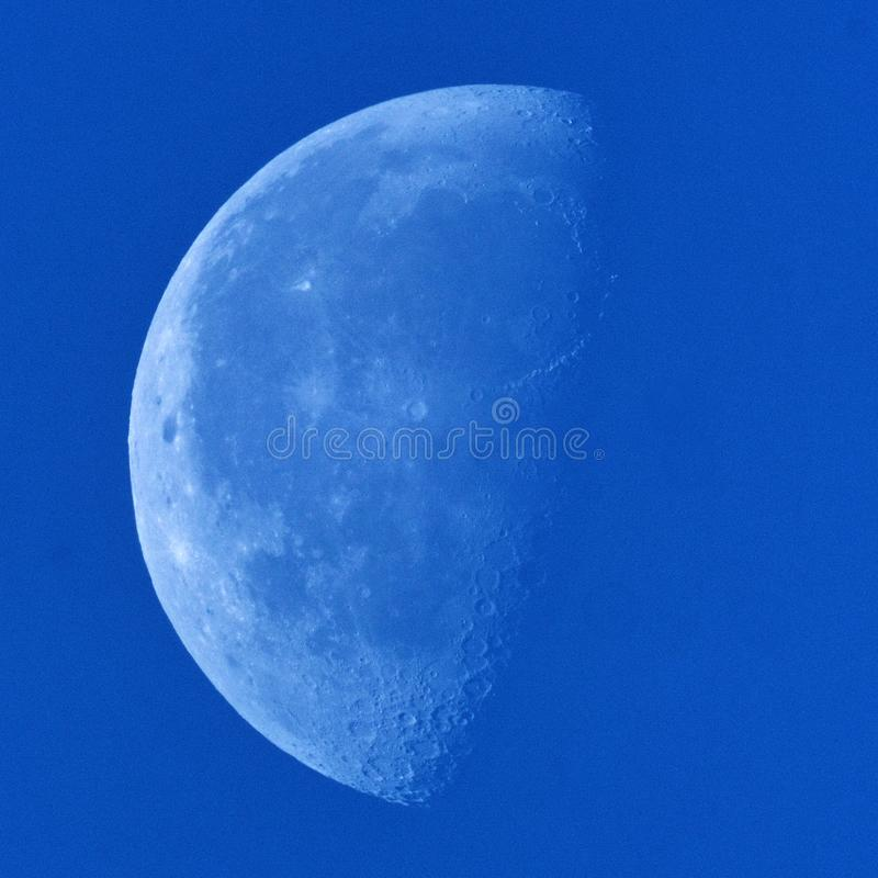 Moon and blue sky after sunrise royalty free stock photo