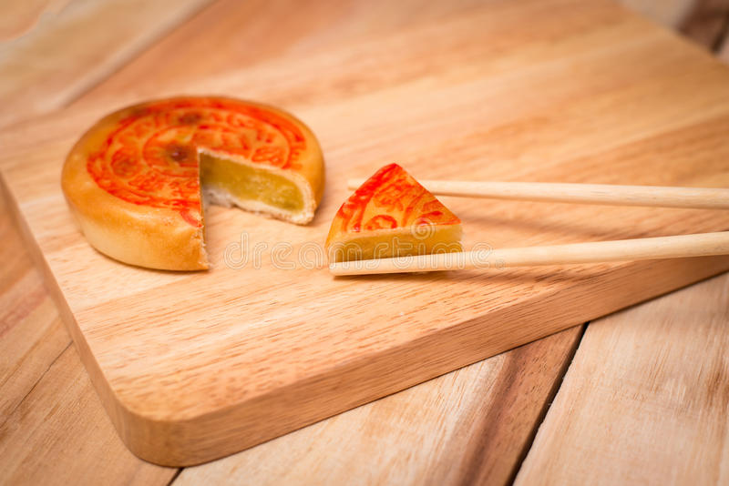 Moon cake,Chinese mid autumn festival dessert. on wooden table stock images