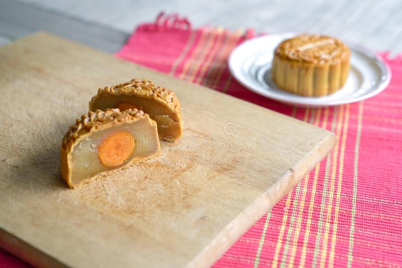 Moon cake cut into half with lotus paste and egg yolk flavor royalty free stock image