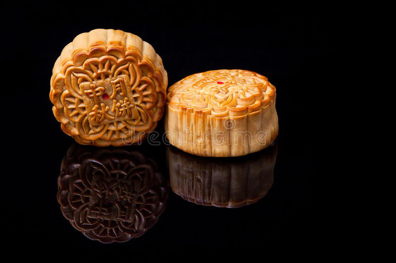Moon cake for Mid-Autumn fastival. Setup moon cake to show chinese font for the chinese Mid-Autumn festival on black background royalty free stock photo