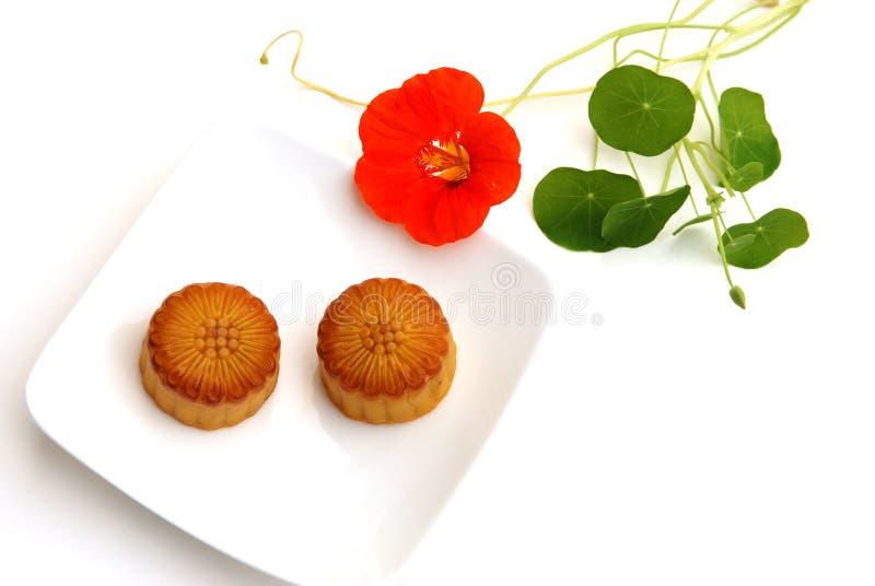 Moon cake and nasturtium stock images