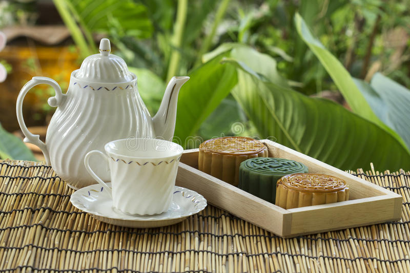 Moon cake on the tray Jug of tea royalty free stock photo
