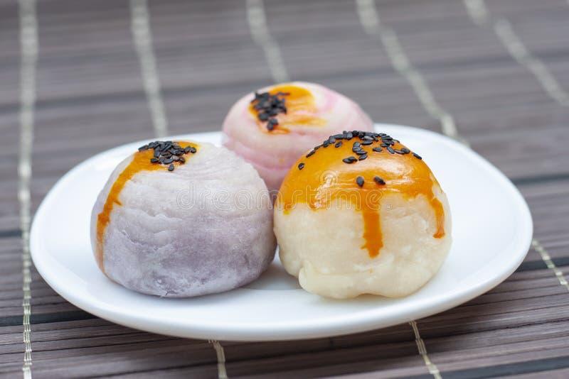 Moon cake Thai people call Kha Nom Pia. Moon cake in white plate Thai people call Kha Nom Pia stock image