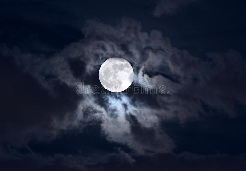 Moon in clouds royalty free stock photo