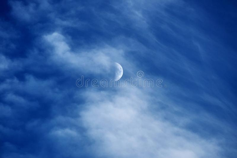 Moon and clouds on blue sky stock photo