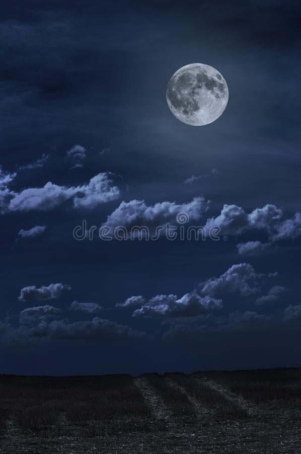 Moon and clouds in the night. Moonlight and road background stock image