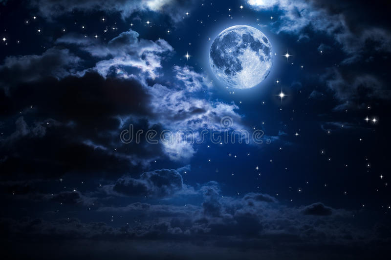 Moon and clouds in the night royalty free stock photography