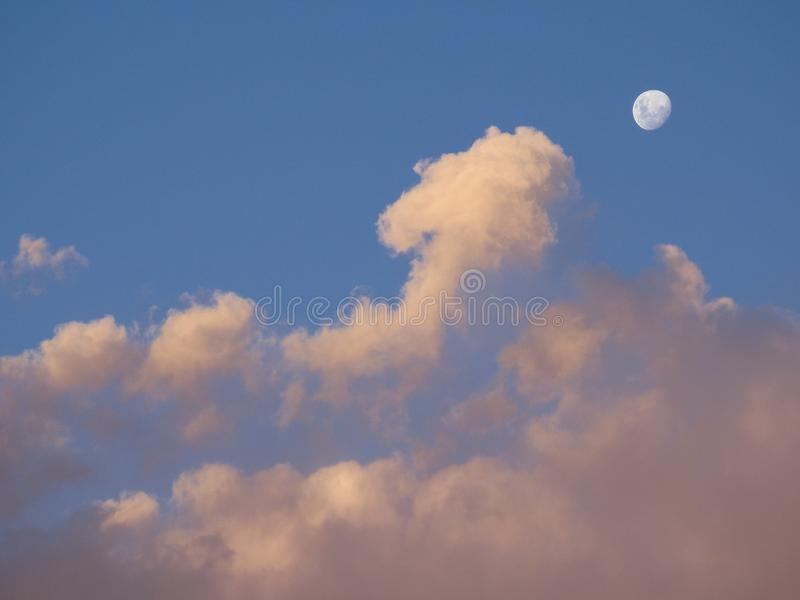 Moon with Clouds at Sunset. In the wonderful sky from Atacama desert stock photography