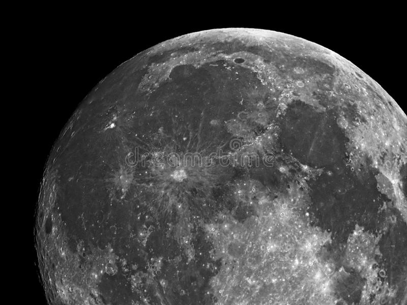 Moon details and crater observing over telescope stock photography