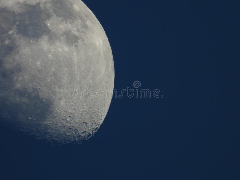 Moon by day royalty free stock photography