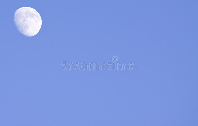 Moon by daylight royalty free stock photos