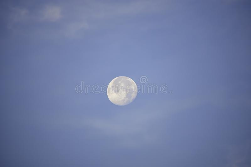 Moon in daylight On the bright sky royalty free stock photography