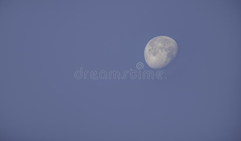 Moon in daylight On the bright sky stock photo