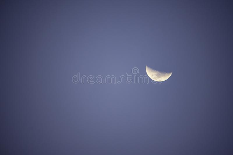 Moon in daylight On the bright sky stock image