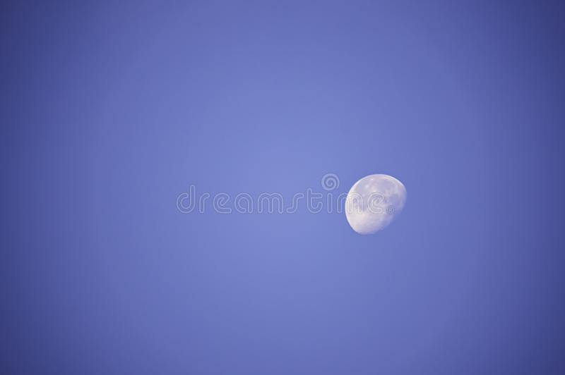 Moon in daylight On the bright sky stock photography
