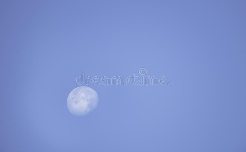 Moon in daylight On the bright sky stock images