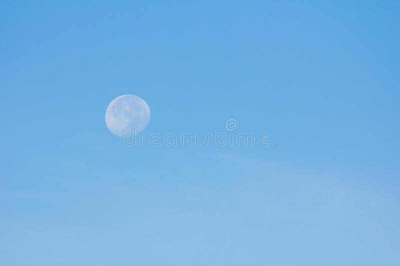 Moon in the daylight stock photography