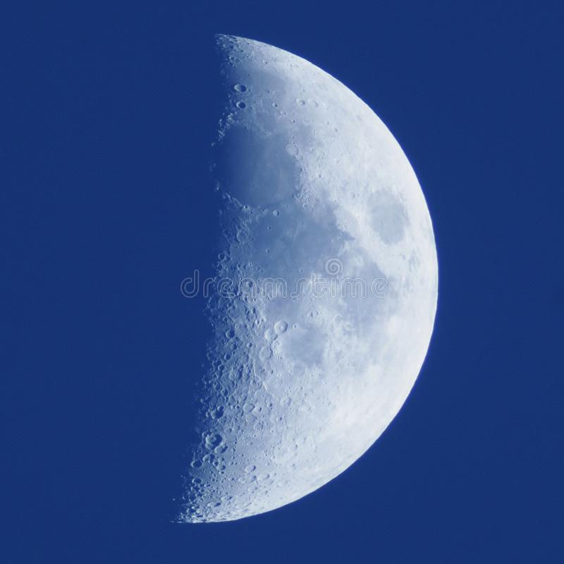 Moon details on blue sky royalty free stock photo