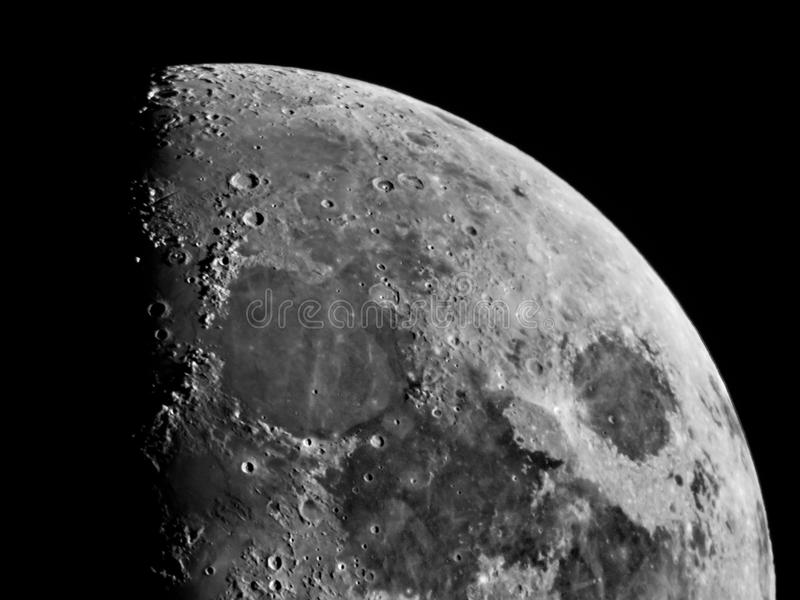 Moon details and craters observing over telescope N200 royalty free stock image