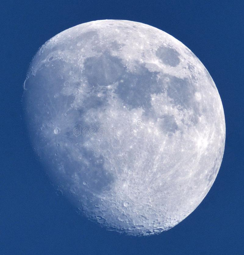 Moon details on blue sky royalty free stock image