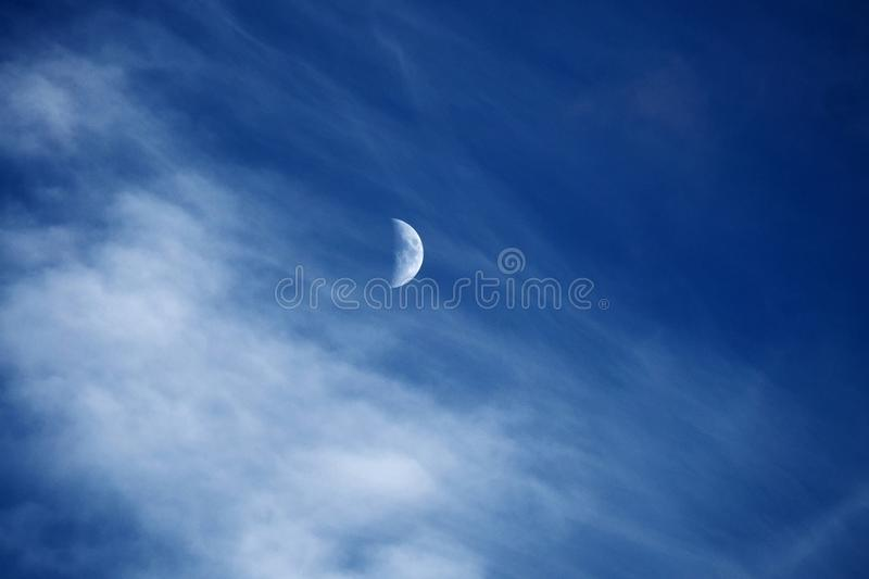 Moon and clouds on blue sky royalty free stock photos